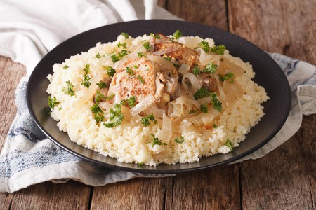 Chicken Yassa with marinated onions and couscous