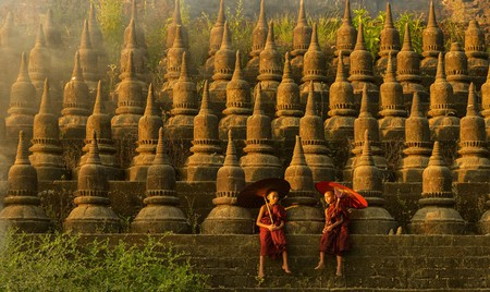 Novice monks hold traditional umbrellas at Ratanabon Paya in Mrauk U, Myanmar | © saravutpics / Shutterstock