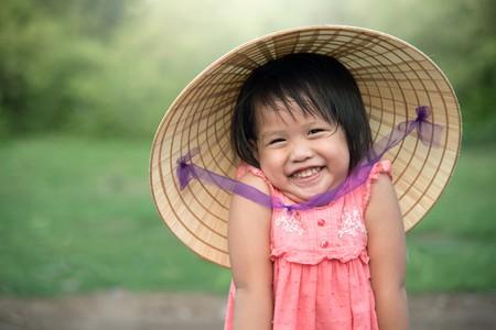 A young Vietnamese girl says hello | © CRStudio / Shutterstock