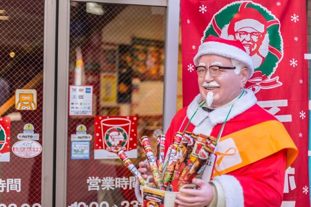 A festive Colonel Sanders greets customers at KFC in Japan   © Quality Stock Arts/Shutterstock