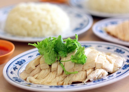 A plate of traditional Hainanese Chicken Rice