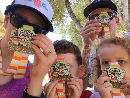 Participants showcasing their Great Candy Corn 5K virtual race medals   © Gone For A Run