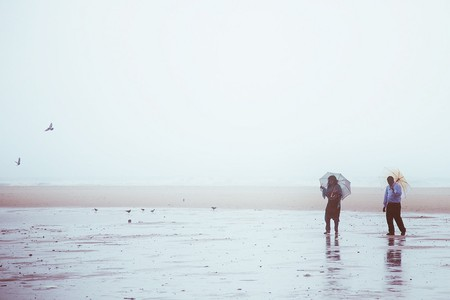 A couple enjoying some alone time on a rainy day in Chennai's Marina Beach |