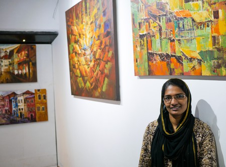 Sara Hussain's paintings hang on display in an art Cafe in Kochi | © Aditi Mukherjee