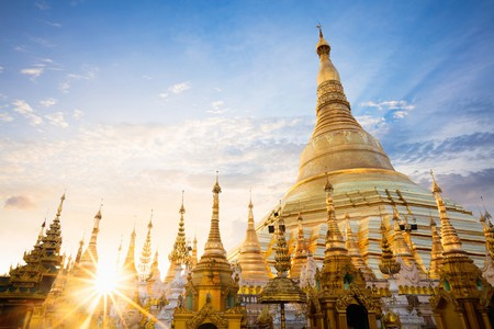 The sun sets behind the Shwedagon Pagoda in Yangon, Myanmar