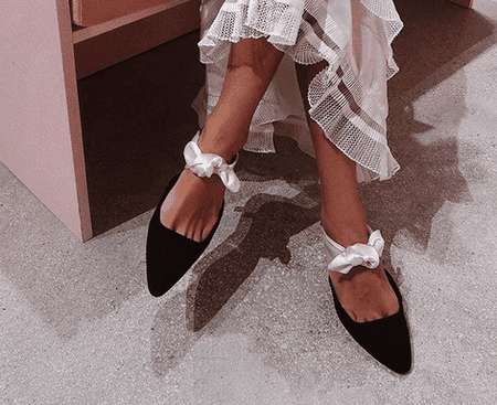 Song of Style in The Row flat shoes | © Instagram @songofstyle