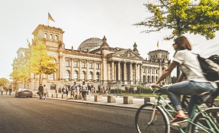 Girl rides past Berlin Reichstag   © canadastock/Shutterstock