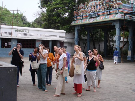 Tourists visiting the Kapaleeswarar Temple as part of a guided walk tour  