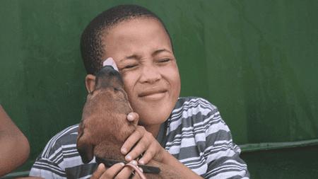 Boy with dog | Courtesy of Funda Nenja