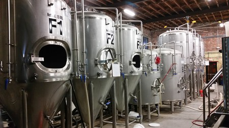 Brewing vats are often visible at brew pubs