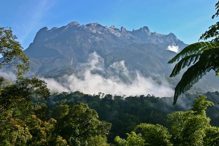 Clouds circling the base of Mount Kinabalu