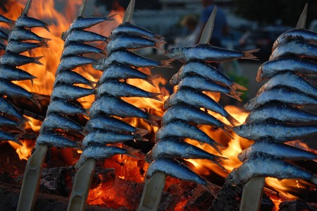 Fish cooking over an open fire on the beach in Marbella