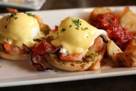Eggs Benedict with bacon and prawns