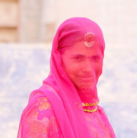 Rajasthani women wearing ghagra and kanchli, covering face with odhni and borla on head