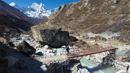 Trekker on Pheriche Pass with Ama Dablam in distance, Sagarmatha National Park