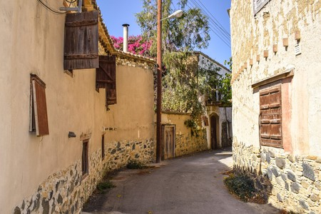 A narrow backstreet between old houses