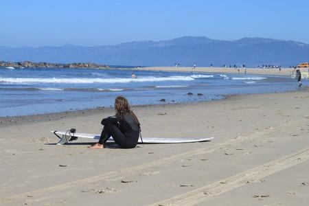 A surfer girl contemplates