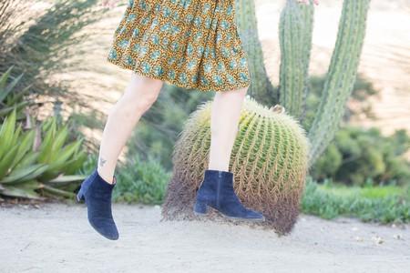 Blogger Vanessa Valiente jumps for joy in her winter boots
