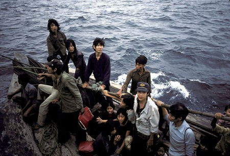 Vietnamese refugees fleeing their homeland by boat