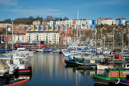 Colourful houses and boats line Bristol's Marina