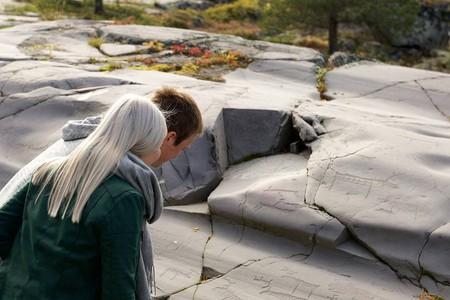 Admiring the rock carvings at Alta