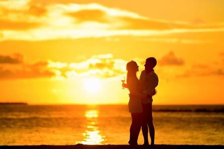 Couple on beach at sunset.