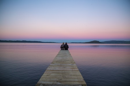 A couple watches the sunset at Lake Rotorua