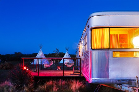 The Imperial Mansion Trailer and teepees are two of many accommodations at El Cosmico