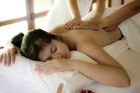 A lady enjoying a soothing massage