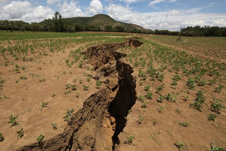 Mandatory Credit: Photo by DANIEL IRUNGU/EPA-EFE/REX/Shutterstock (9569193j) A huge crack that has sliced through the ground around the Rift Valley area close to Mai Mahiu town, some 50 km southwest of Nairobi, Kenya, 06 April 2018.  The sudden appearance of the crack have forced residents to flee their homes and farms. The fissures may be caused by seismic activity and erosion caused by heavy rains. Huge cracks develop along Kenya's Rift Valley town of Mai Mahiu - 06 Apr 2018