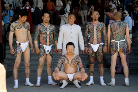 Men display their Yakuza-style tattoos at a festival in Asakusa, Tokyo