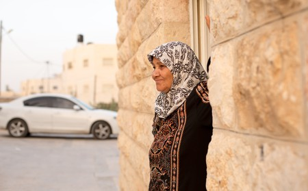 The matriarch of the Abusarah family stands outside her home in al-Azariya, West Bank, May 2018