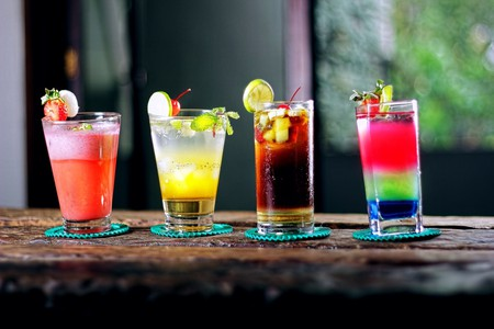 Tropical cocktails idea with bright colours in a cool bar