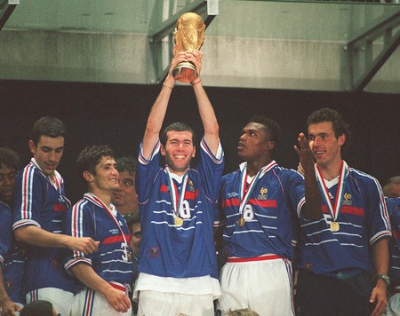 France's Zinedine Zidane lifts the World Cup trophy in 1998