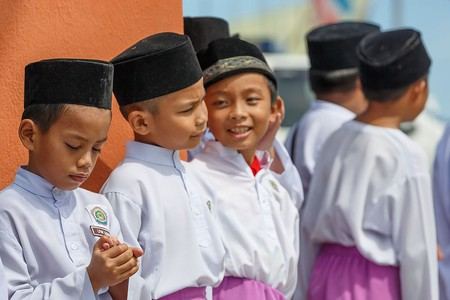 School boys wearing songkok