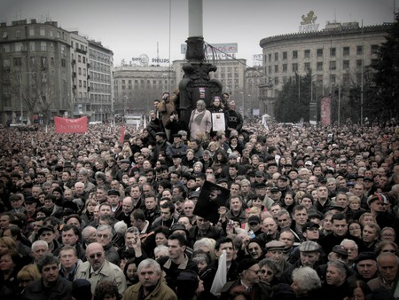 People gather in Belgrade for the funeral procession of Slobodan Milošević