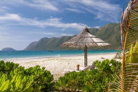 Straw umbrella on a tropical beach on a Con Dao island, Vietnam