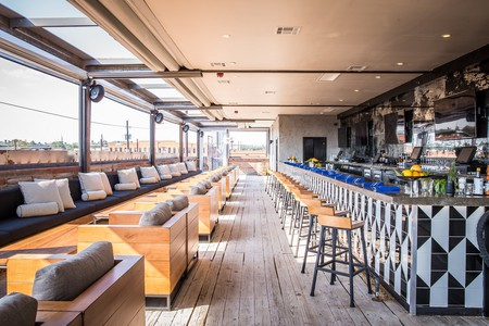 Stirr's stylish rooftop bar is a hotspot on the weekends with cocktails, snacks, and great views.