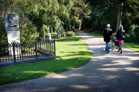 Danes taking a stroll at Assistens Cemetery in Nørrebro