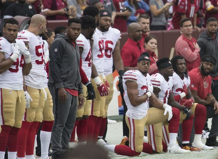 San Franciso 49ers players kneel during the national anthem