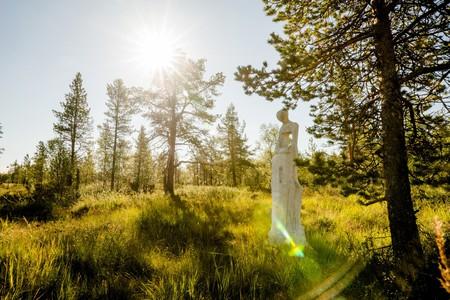 A sculpture in the summer landscape at Kakslauttan Resort, Finland