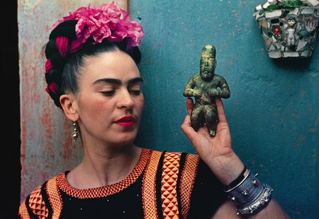 Frida Kahlo with Olmec figurine, 1939