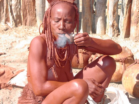 A Himba woman enjoying a smoke