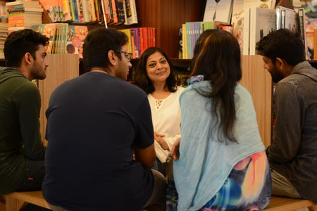 A group of readers engaging in a conversation with a human book at a Human Library event
