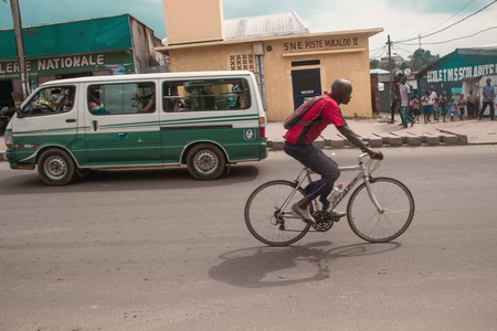 A man cycles through the streets of Brazzaville