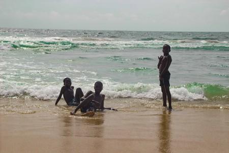 Children swimming at a beach