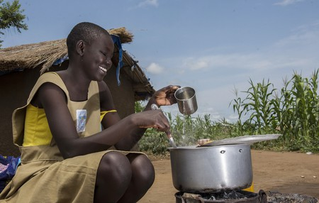 A girl prepares a meal with clean water