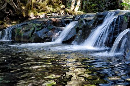 A cascade of waterfalls at Devil's Hole near Breitenbush hot springs in Oregon.