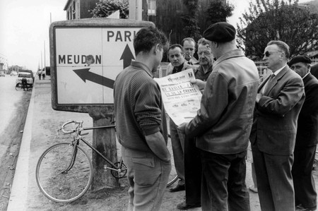 Locals read the newspaper about the assassination attempt on Charles de Gaulle in 1962
