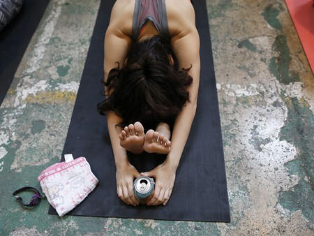 A yoga enthusiast attends a Beer Yoga class in Bangkok, Thailand